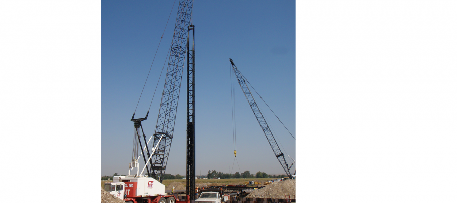Crews drive pylons into the ground for testing