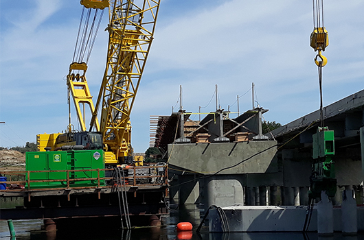 crane places girders for bridge