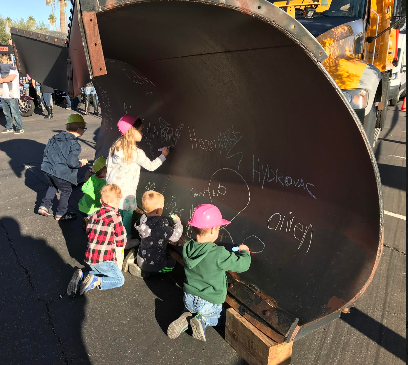 Kids sign names during Touch a Truck