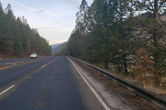 A car passes the Orofino Airport on US-12