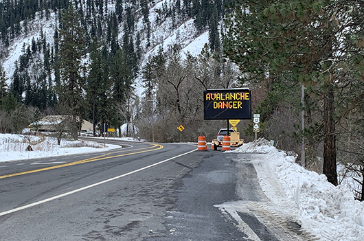 A sign along US-12 warns drivers of avalanche danger