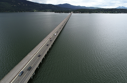 Cars cross Lake Pend Oreille on the Long Bridge